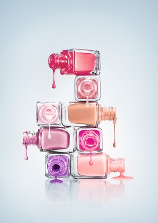 cosmetic lacquer: Nail polish dripping from stacked bottles