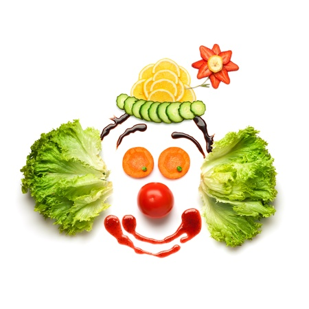 Happy meal for opponents of fast-food  A nice and funny edible clown, made of strawberries, lemons, salad and so on