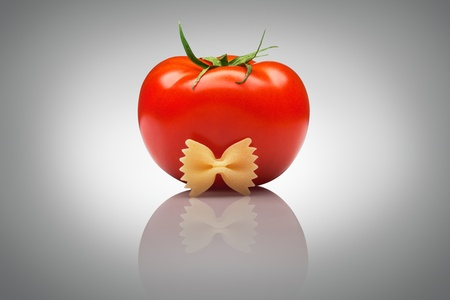 mannerism: Quite an imposing sir tomato  A nice ripe tomato with a macaroni bow tie.