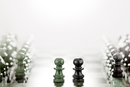 opposition: First move: two pawns opposition in the middle of the board. Stock Photo
