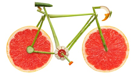 Road bicycle made of fruits and vegetables on white background.