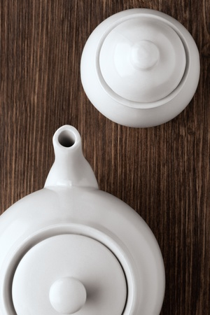 Your tea is ready, are you - An image of white china tea pot and sugar bowl on wooden table  Stock Photo - 18666515