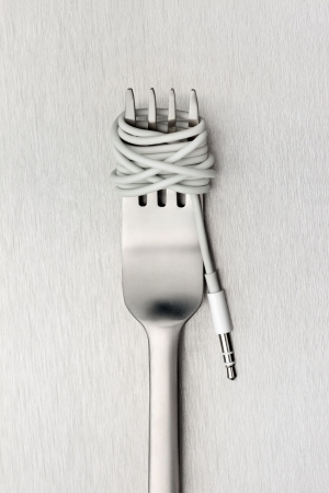 unhealthy thoughts: Food for new generation - A shining fork with noodle made of cable with music jack plug in metal background