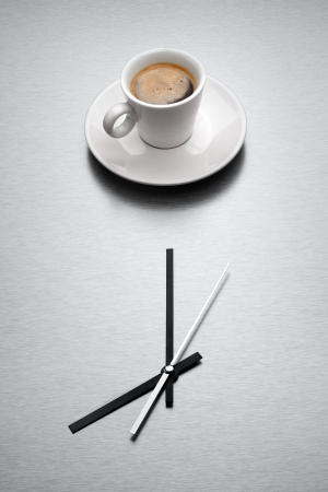 Express yourself espresso style  - A white mug filled with coffee over minimalistic clock Stock Photo - 18666513