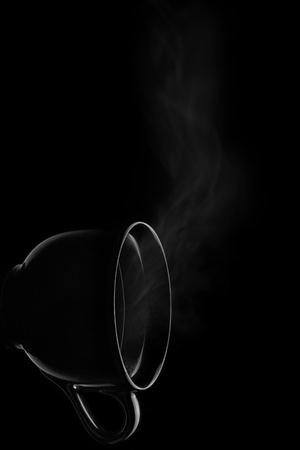 Another view another taste - The turned cup filled by steamy hot drink  Stock Photo - 19380050