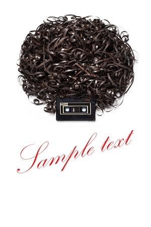 wig: Lenny Kravitz - Twist it reggae style - A head with afro hairdress made of audio tape  Stock Photo