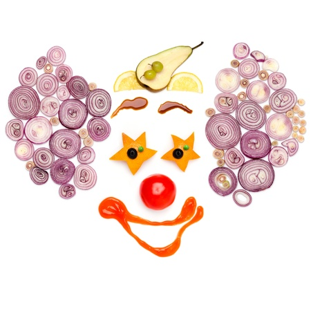 Laugh up to tears - A star-eyed clown made of vegetables. Imagens