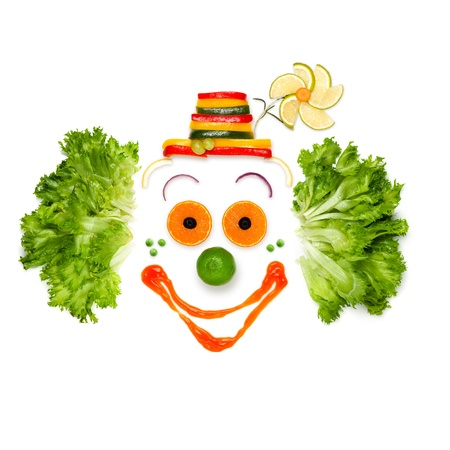 clown face: Cheer your life like your food does - A portrait of joyful clown made of vegetables and sauce.