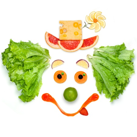 The friendly food the friendly mood -A friendly clown made of vegetables and sauce. Stock Photo - 19380105