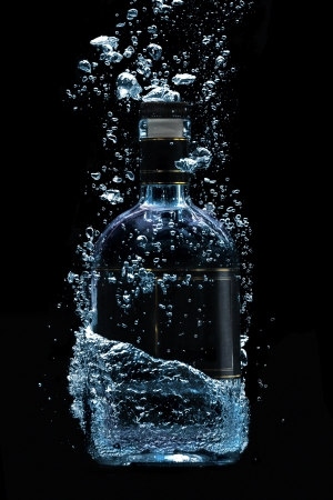 vodka bottle: An alcohol diver - A photo of dipping luxury alcohol bottle  Stock Photo