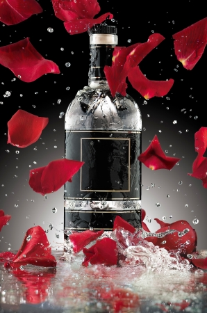 vodka bottle: An alcohol romance - A photo of luxury alcohol bottle with falling rose leaves