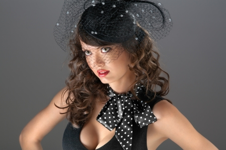 A sight through the web - A photo of puzzled beauty in the web hat  photo