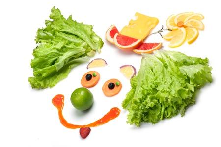 caes: Si caes mejor se enamoran - Un payaso feliz hecho de frutas y verduras