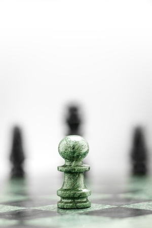 chequer: A pawn on the chequer before the shapes  Stock Photo