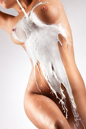 A photo of woman body with milk flowing down