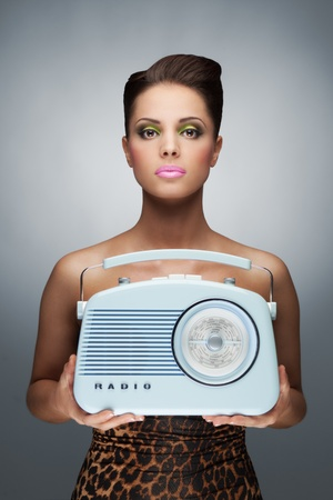 radio active: A colourful photo of beauty hanging the retro radio