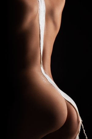 The hot picture of woman back with milk flowing down