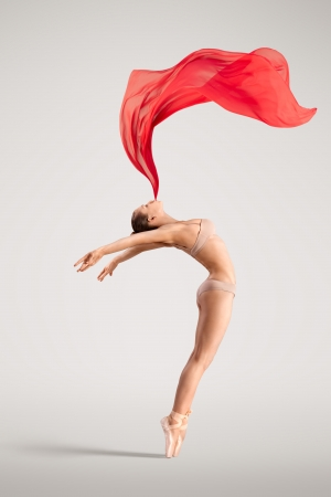 The lovely photo of a girl dancing with red cloth  photo