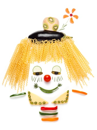 A portrait of shy clown made of vegetables and noodles