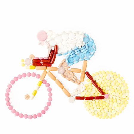 Doping drugs and pills in the shape of a road bicycle racer on a bike. photo