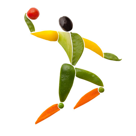 Fruits and vegetables in the shape of a volleyball player making a jump serve.