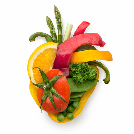 A healthy human heart made of fruits and vegetables as a food concept of smart eating. photo