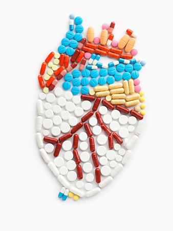 Drugs and pills in the shape of a human heart. photo