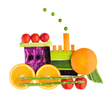 Food concept of a vintage locomotive made of vegs and fruits, isolated on white.