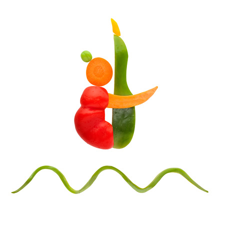 Fruits and vegs arranged in a diver shape jumping in a pike position.