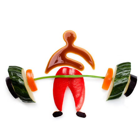 vegs: Fruits and vegs icon of a healthy muscular bodybuilder lifting a barbell. Stock Photo