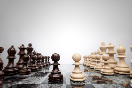 chess board: First move: two pawns opposition in the middle of the board . Stock Photo