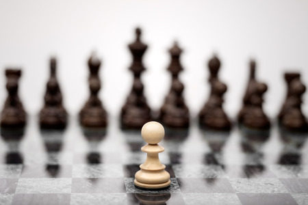 A pawn on the chequer before the shapes. Stock Photo