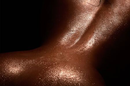 A close up macro photo of beautiful female back.
