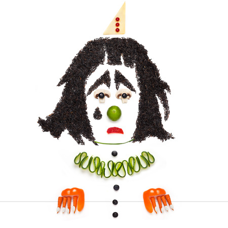 pierrot: A creative food concept of a crying dramatic Pierrot made of vegetables and fruits. Stock Photo