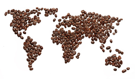 A world map made of roasted coffee beans showing that people drink coffee worldwide. photo