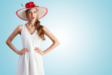 An enigmatic photo of the girl in vintage hat and white dress. photo