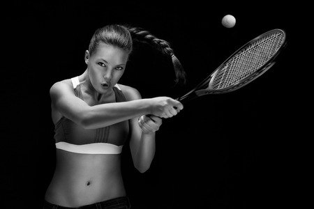 A portrait of a tennis player with a racket. photo