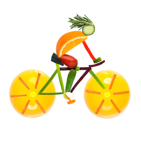 Fruits and vegetables in the shape of a male cyclist on a road bike