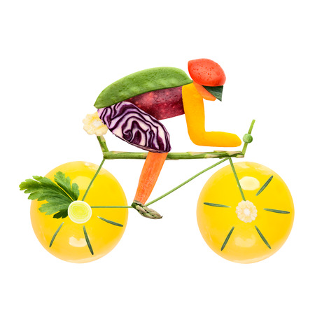 road bike: Fruits and vegetables in the shape of a male cyclist on a road bike