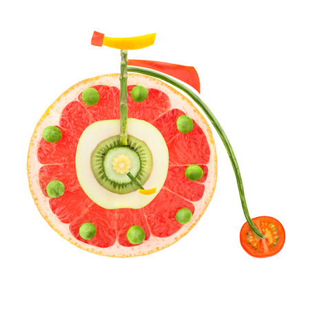 old fashioned vegetables: Fruits and vegetables in the shape of a vintage penny-farthing bicycle  Stock Photo