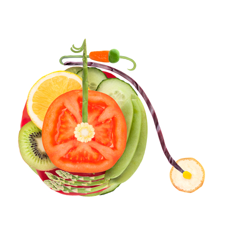 Fruits and vegetables in the shape of an old penny-farthing bicycle  photo