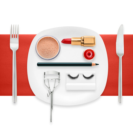 A fashion concept of makeup accessories on a plate as a cosmetics food  Stock Photo