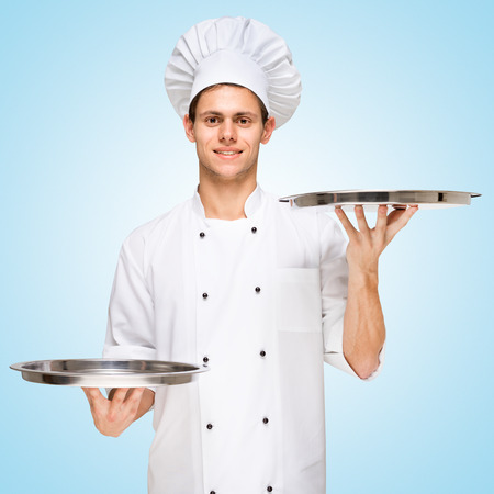 Restaurant chef serving a copy space for menu with prices on a tray  photo
