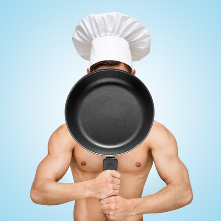 Naked restaurant chef hiding behind a frying pan for a menu with prices