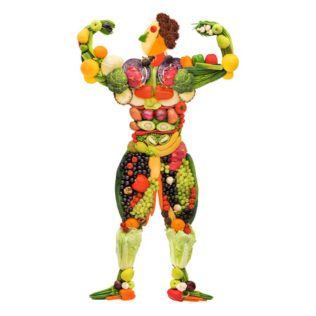 vegan food: Fruits and vegetables in the shape of a healthy posing muscular bodybuilder  Stock Photo