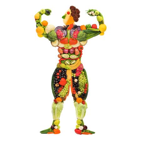 Groenten en fruit in de vorm van een gezonde poseren gespierde bodybuilder Stockfoto