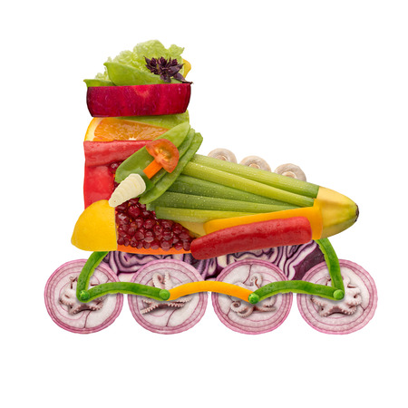 speed skating: Healthy food concept of inline roller skate made of fresh vegetables full of vitamins, isolated on white. Stock Photo