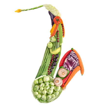 tenor: Healthy food concept of classical wind instrument saxophone made of fresh vegetables full of vitamins, isolated on white.