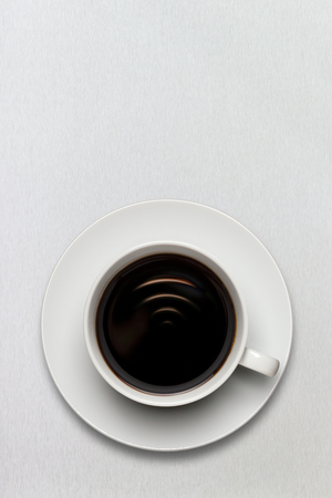 A cup of coffee full of fresh black american espresso with internet connection sign. photo