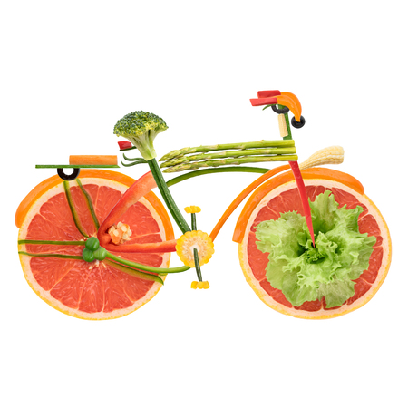 Fruits and vegetables in the shape of an urban fixed gear bicycle in detail isolated on white background. Imagens
